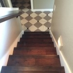 Solid wood Stairs with Gray and White Porcelain tiles with Marble inserts